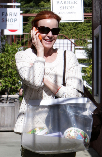 Marcia Cross Marcia Cross keeps her phone glued to her ear as she  shops for Easter gifts at the Brentwood Country Mart.