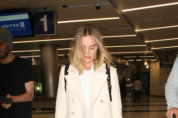 Margot Robbie Margot Robbie and Tom Ackerley Are Seen at LAX