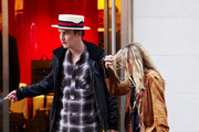 Actress Mary-Kate Olsen hides her face when she spots cameras after leaving the Tumi store with her boyfriend Nate Lowman.