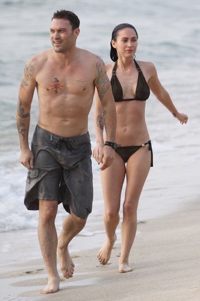 "A bikini-clad Megan Fox was spotted on the beach in Hawaii with her boyfriend Brian Austin Green. The former ""Transformers"" babe looks great as she shows her ""six pack"" abs and toned legs as she swimw in the ocean and plays on the beach over the US Memorial Day holiday."
