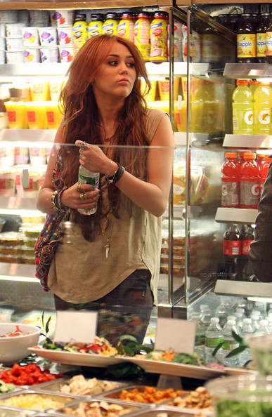 Miley Cyrus gets indecisive at the food counter line inside Cafe Metro as she stops in for a bite.