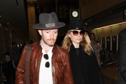 Natalie Dormer and Anthony Byrne are seen at LAX.