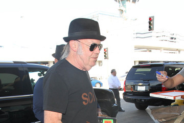 Neil Young Daryl Hannah and Neil Young Are Seen at LAX