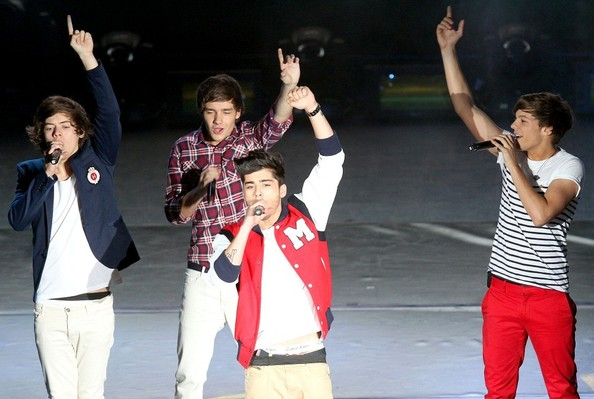 One direction bandmates, Niall Horan, Zayn Malik, Liam Payne, Harry Styles and Louis Tomlinson perform in concert at the Auditorio Nacional.