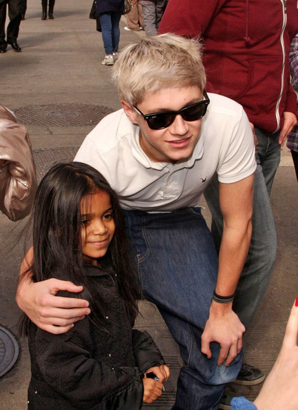 "Naill Horan of the British-Irish boy band ""One Direction"" poses with fans and hams it up for the cameras as he walks through mid-town Manhattan."