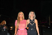 Paris Hilton and Megan Pormer are seen.