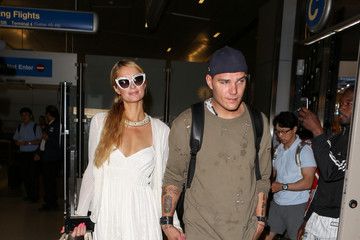 Paris Hilton Paris Hilton and Chris Zylka Land at LAX