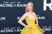 Amanda Seyfried  is seen attending at the Premiere of 20th Century Fox's 'The Art Of Racing In The Rain' held at El Capitan Theatre in Los Angeles, California.