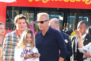 Kevin Costner and Kylie Cantrall are seen attending at the Premiere of 20th Century Fox's 'The Art Of Racing In The Rain' held at El Capitan Theatre in Los Angeles, California.