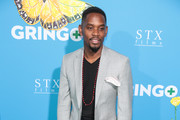 Aml Ameen is seen arriving for the Premiere of Amazon Studios And STX Films' 'Gringo' held at Regal LA Live Stadium 14 in Los Angeles, California.