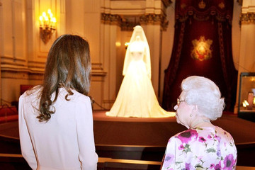 Kate+Middleton in The Queen and Catherine view the wedding dress