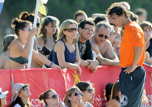 Rafael Nadal Rafael Nadal plays a game of beach volleyball and relaxes in the ocean with his girlfriend Xisca Perello, with whom he is very affectionate.