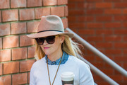 Reese Witherspoon Stays Covered Up