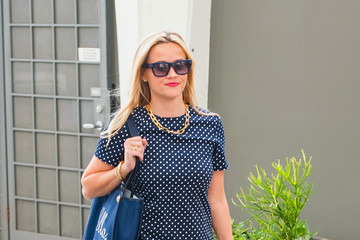 Reese Witherspoon Reese Witherspoon's Goes out in Polka Dots and Red Heels
