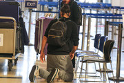 Russell Brand and Laura Gallacher Visit LAX