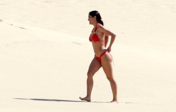 With her voluptuous body and Black hairtype without bra (cup size 36C) on the beach in bikini