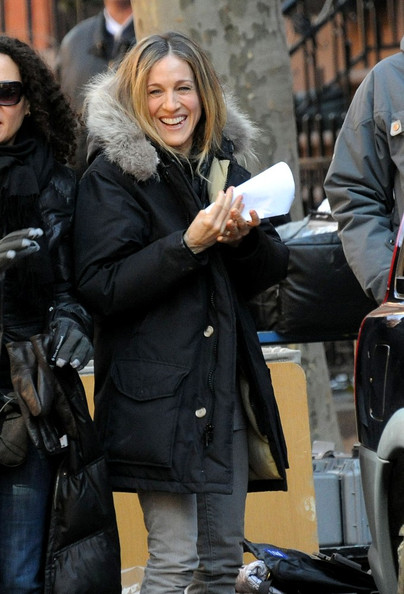 "Sarah Jessica Parker and Greg Kinnear share a laugh as they arrive on the Brooklyn set of ""I Don't Know How She Does It""."