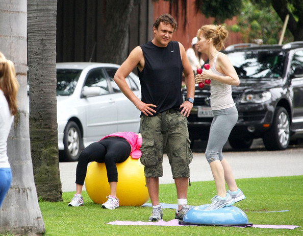 "Jason Segel gives Leslie Mann a workout on a Bosu Ball as they film an outdoor exercise scene for ""This is 40."" ."