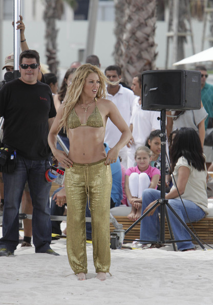 Shakira Shakira stands out in gold as she films scenes for her music video.