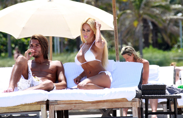 Shauna Sand and her on-again, off-again ex-husband Romain Chavent, sun bathe in the Miami sun.