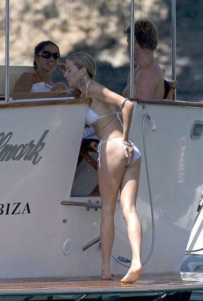 Sienna Miller looks to have put her tumultuous relationship with Balthazar Getty behind her as she vacations with new boyfriend George Barker, aka DJ Slinky Wizard. The pair spent the day hanging out on a boat, snorkeling, kissing and drinking beer.