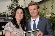 Simon Baker honored with star on the Hollywood Walk of Fame. .Hollywood, CA..February 14, 2013..Job: 130214A1..(Photo by Axelle Woussen)..Pictured: Simon Baker and Robin Tunney..