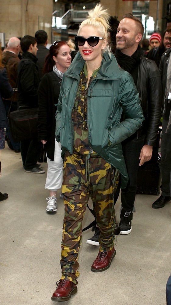 Gwen Stefani wears a camouflage jump suit as she arrives at Gare du Nord train station with her son Zuma.