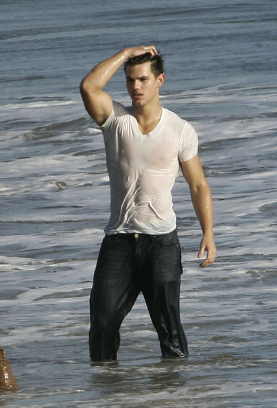 Taylor Lautner Taylor Lautner star of the Twilight movies takes part in a magazine photoshoot on a Malibu beach showing off his acrobatic skills as well as riding a motorbike along the sand.