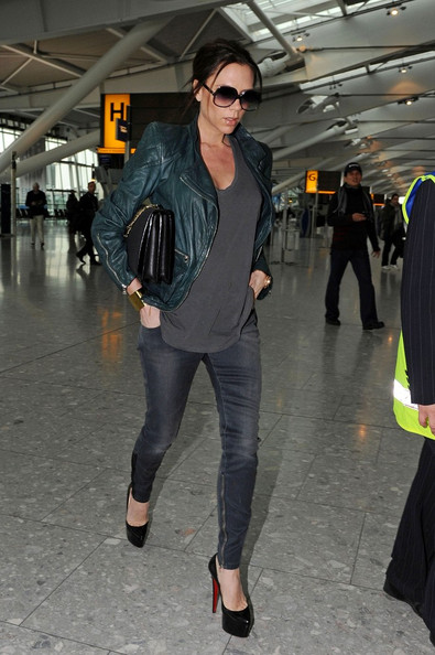 Victoria Beckham Despite being pregnant with her first daughter Victoria Beckham still wears sky-high heels before flying out at London Heathrow Airport.