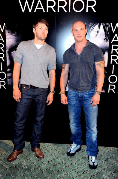 "Tom Hardy and Joel Edgerton pose at a photocall for their film ""Warrior"" held at the Bristol Hotel."