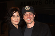 Carrie-Anne Moss and Steven Roy Photos Photo