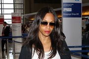 Zoe Saldana Arrives at LAX