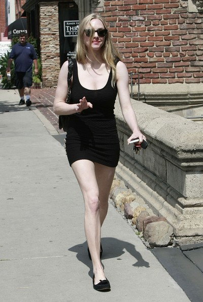 Actress Amanda Seyfried leaves a cafe after getting breakfast then heads to a casting office in Los Angeles. She looked very excited on her way out.