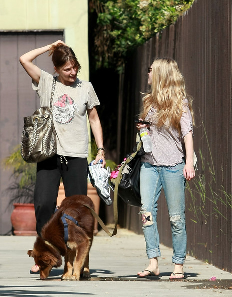 Actress Amanda Seyfried leaves a gym with her dog and friend in West Hollywood.