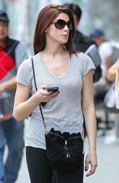 Actress Ashley Greene walks with her father Joe Greene through the