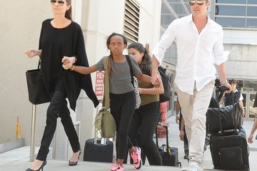 Brad Pitt The Jolie-Pitt Family Arriving On A Flight At LAX