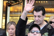 Charlie Sheen leaves his midtown NYC hotel for his next show in Connecticut. Walking behind Sheen are actor Chuck Zito and one of his girlfriends Rachel Oberlin. Charlie also has a 'C' tattooed on his wrist.