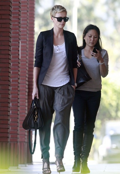 Charlize Theron looked cool and casual with a navy blazer while out at the Disney Studios.
