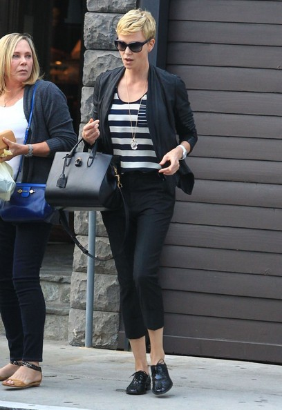 Charlieze Theron kept her look black-and-white with this blazer, which she paired over a striped top, and a pair of capri pants.