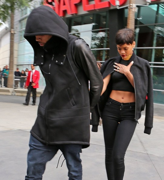 Chris Brown Singers Chris Brown and Rihanna walking hand in hand upon leaving the Los Angeles Lakers basketball game at Staples Center on Christmas day in Los Angeles, California on December 25, 2012. The couple looked very happy celebrating Christmas together.