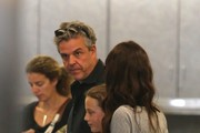 """Wolverine"" actor Danny Huston, his wife Olga Kurylenko, and their daughter Stella arrive at LAX in Los Angeles, California on January 3rd, 2013."