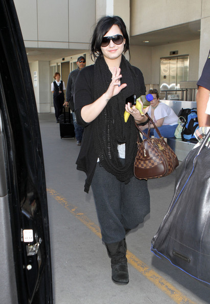Demi Lovato Actress Demi Lovato gets a police escort out of LAX airport past the waiting photographers after arriving on a flight into Los Angeles.