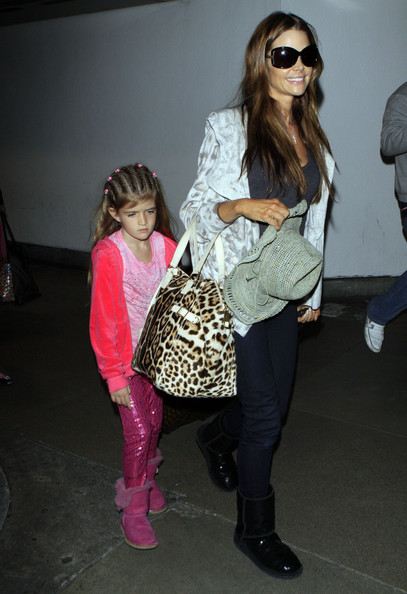 Denise Richards Actress Denise Richards and her two daughter Sam and Lola arriving on a flight from their vacation in Hawaii at LAX airport in Los Angeles, CA.