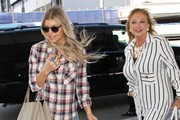 Fergie Catches A Flight With Her Mom