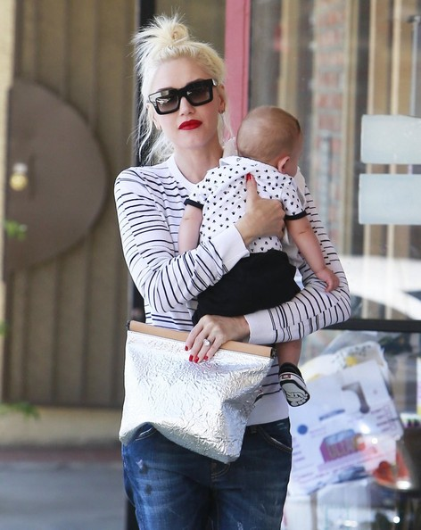 Singer and busy mom Gwen Stefani stops by a Acupuncture Studio with her baby boy Apollo in Los Angeles, California on August 11, 2014. Gwen and her family have been traveling a lot lately, spending time together in Gavin's hometown of London as well as Italy.