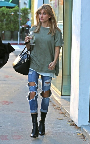 7247fdd0f93 jeans denim white jeans ripped jeans boots knee high boots jacket bella  thorne shoes blouse. Hailey Baldwin s Ripped Jeans and Black Boots