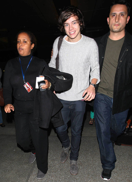 One Direction singer Harry Styles makes his way through LAX after touching down in Los Angeles, California on May 1st, 2012.