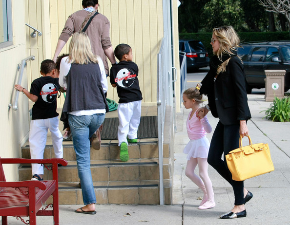 Heidi Klum Model Heidi Klum and her kids Leni, Henry, Johan and Lou spotted out in Brentwood, CA. Heidi was carrying Lou while taking Leni to ballet class while her nanny was taking Henry and Johan to karate class.