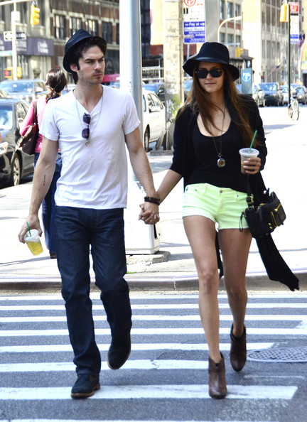 """Lost"" star Ian Somerhalder and his ""Vampire Diaries"" girlfriend Nina Dobrev walk hand-in-hand in matching fedoras in New York, New York on May 13th, 2012."