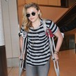 Chloe Grace Moretz Uses Crutches at LAX
